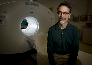 Ramsey Badawi, director of Nuclear Medicine Research at UC Davis, poses in front of a positron emission tomography scanner at the UC Davis Medical Center on Oct. 2, 2015.